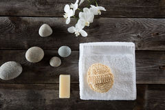 Top view for detox spa with cleansing loofah and zen symbols. Top view still life for detox spa with cleansing loofah, zen white towel and orchids and beautiful Royalty Free Stock Photos