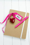 Top-view of diary with pen and heart symbol Royalty Free Stock Images