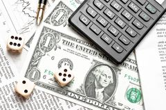 Top of view of dice on financial chart near dollars and calculator Stock Photography
