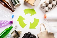 Top view of Different garbage materials with recycling symbol on white wooden table background. Recycle, World Environment Day and. Eco concept royalty free stock photography