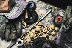 Top view of different goldsmiths tools on the jewelry workplace. Aerial view of tools over rustic wooden background. royalty free stock photos