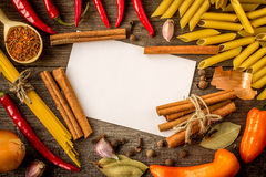 Top view of different italian pasta with spices Royalty Free Stock Photography