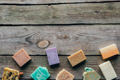 Top view of different natural homemade soap. On wooden surface royalty free stock photos