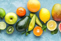 Top view of different selected juicy organic tropical fruits. Superfood, healthy food background Stock Photo