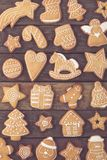 Cookie world. Top view of different shapes of nicely decorated Christmas cookies on wooden background stock image