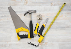 The top view of different working tools lying on wooden workbench Stock Images