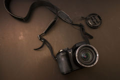 Top view of digital camera with brown background. Digital camera with brown background Stock Photo