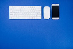 Top view of digital smartphone, keyboard and computer mouse Royalty Free Stock Photography