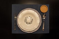 Top view of dinner place setting. A white plate on wooden table stock photography