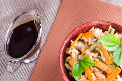 Top view of a dish of rice, carrots and beans Royalty Free Stock Images