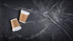 Top view of disposable take-out mock-up white paper coffee cups with kraft brown holder stock photography