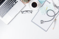 Top view of doctor desk table with stethoscope. Coffee  and notebook with pen. Top view with copy space, flat lay Stock Image
