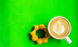 Top view, donut, chocolate, sweets and hot coffee or latte art. On a green background. Top view, donut, chocolate, sweets and hot coffee or latte art. On a green stock photos
