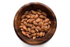 Top view dried almond in wood bowl on white background. stock images