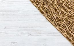 Top view, dried chick peas on white wooden table. royalty free stock image