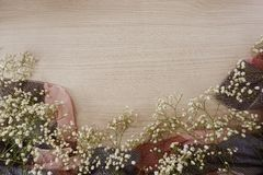 Dried flowers on wooden background. Top view of dried flowers bouquet on space copy wooden background stock photo