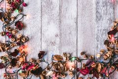 Top view of Dried flowers with Christmas lights on wooden table background. Free space for your text. Seasonal, Festival and Holiday Concept Stock Image