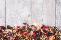 Top view of Dried flowers with Christmas lights on wooden table background. Free space for your text. Seasonal, Festival and Holiday Concept Stock Photos