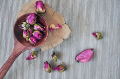 Top View of Dried Roses put on Wooden. Top view of dried roses in spoon put on wooden Stock Photo