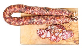 Top view of dried smoked sausage on cutting board Royalty Free Stock Images