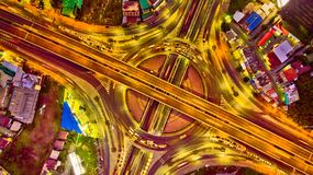 Top view from drone. Arial view Expressway motorway highway circus intersection at night, Bangkok, Thailand. stock image