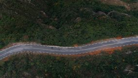 Two motorcycles on winding epic mountain road stock footage