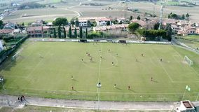 Top view from drone of football soccer field- Two teams playing a match and having a competition stock video footage