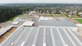 Slate roofs of modern large fenced animal farm with paddocks for cows and sheeps. Top view from drone of several buildings with slate roofs belonged to modern stock footage