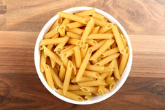 Top view of dry penne rigate in white ceramic bowl Royalty Free Stock Photography