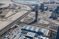 The top view on Dubai downtown from the tallest building in the Stock Image