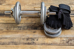 Top view of dumbbells, extra weights and black gloves Royalty Free Stock Photos
