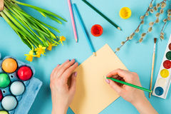 The top view of easter on blue table office workplace Stock Photography
