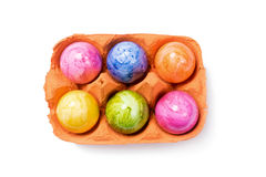 Top View -Easter Eggs in Egg Carton on white Background. Top View - Easter Eggs in Egg Carton  on white Background Stock Photo