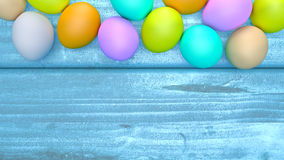 Top view of Easter eggs on a wooden table. Stock Photography