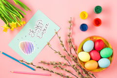 The top view of easter on pink table office workplace Royalty Free Stock Images