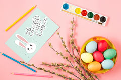 The top view of easter on pink table office workplace Royalty Free Stock Photography