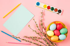 The top view of easter on pink table office workplace Royalty Free Stock Image