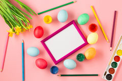 The top view of easter on pink table office workplace Stock Images