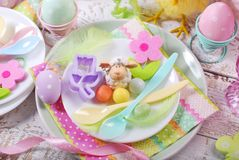 Easter table setting for kids in pastel colors Royalty Free Stock Photos
