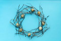 Top view easter wreath composition with quail eggs isolated on blue background stock images