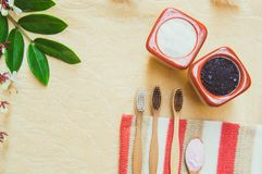 Top view Eco friendly natural bamboo toothbrush place on wooden plates and toothpaste made from salt,charcoal and Aloe,concept. Reduce use plastic for stock images