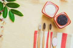 Top view Eco friendly natural bamboo toothbrush place on wooden plates and toothpaste made from salt,charcoal and Aloe,concept. Reduce use plastic for royalty free stock photography