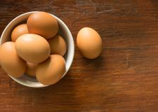 Top view of eggs in white bowl on wooden background Stock Photography
