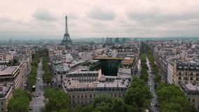 Top view of the Eiffel Tower and the roofs of the capital. Paris, France Slow Motion. Cityscape cars on the road. Shot. From the arch of triumph stock video