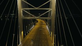 Top view elements metal structure modern cable stayed car bridge in night city