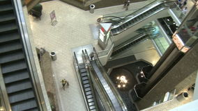 Top view of elevators and escalators moving within mall (2 of 2). A view or scene of Shopping stock video footage