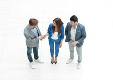 Top view.employees shaking hands royalty free stock photo