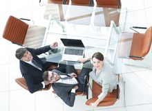 Employees sitting at the desk and looking up. Top view .employees sitting at the desk and looking up Royalty Free Stock Images