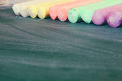 Top view of empty blackboard with colorfull chalks Royalty Free Stock Image