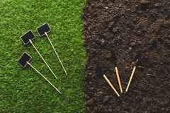 Top view of empty blackboards on grass and gardening tools on soil royalty free stock images